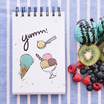 Notepad mockup with ice cream and fruits