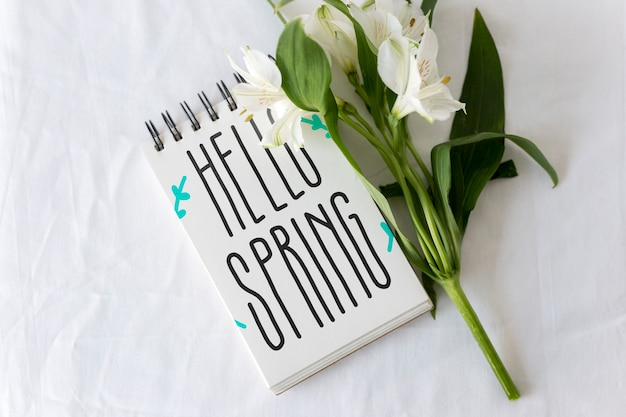 Notepad mockup with spring flowers