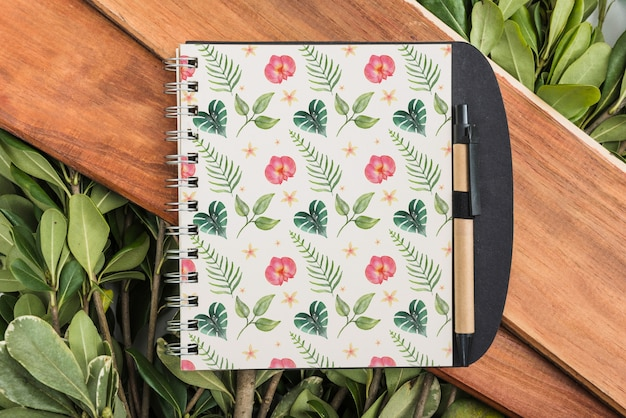 Notepad mockup with tropical leaves
