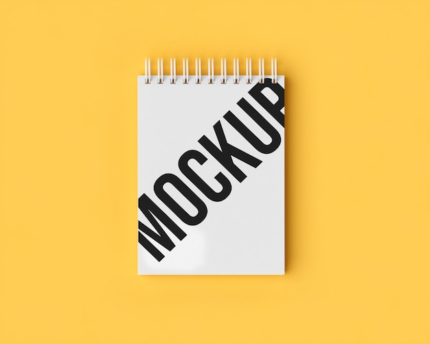 Notepad mockup on yellow