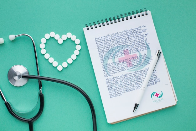 Notepad and stethoscope medical mock-up