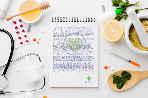 Notepad with healthy ingredients flat lay