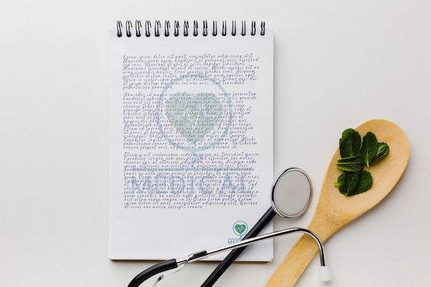 Notepad with mint leaves flat lay