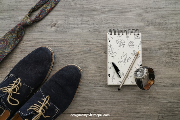 Notepad with shoes and tie