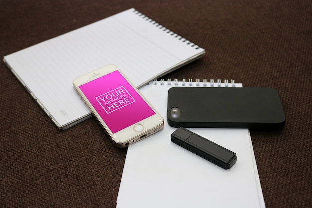 Notepad with smartphone and flash drive