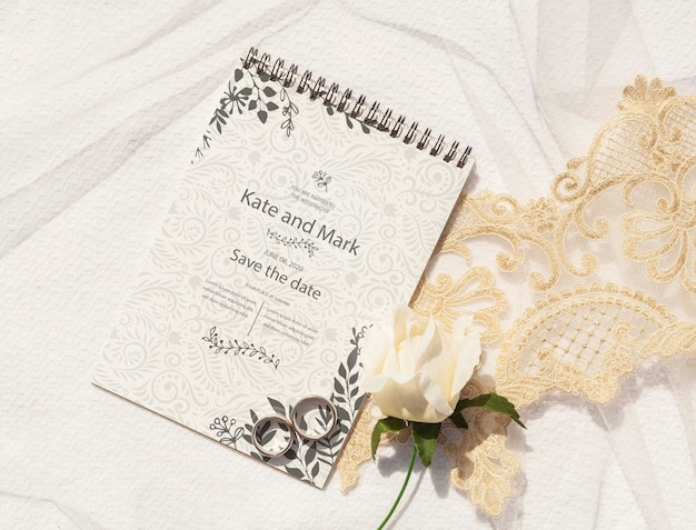 Notepad with wedding ideas and wedding rings