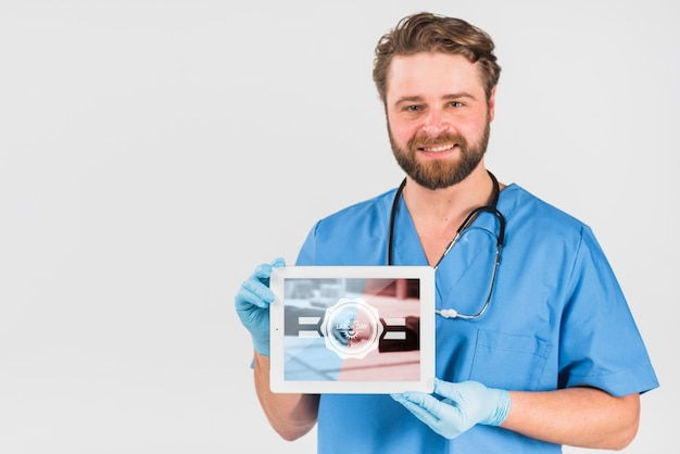 Nurse holding tablet mockup for labor day