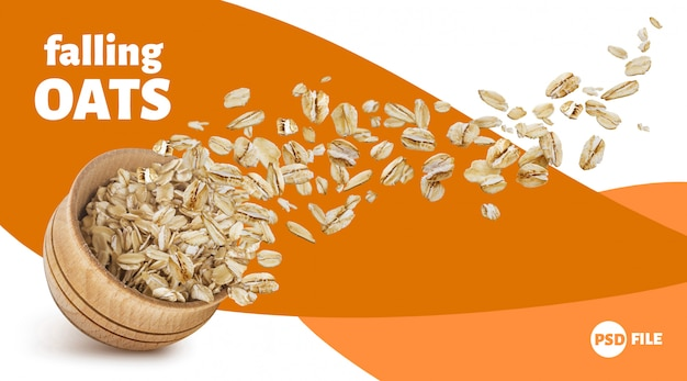 Oat flakes flying out of wooden bowl