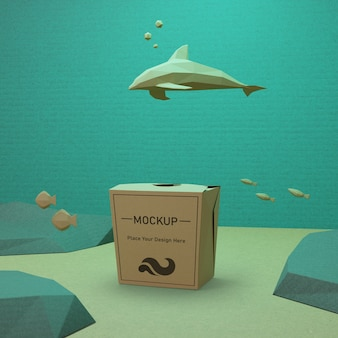 Ocean day concept with paper bag and dolphin