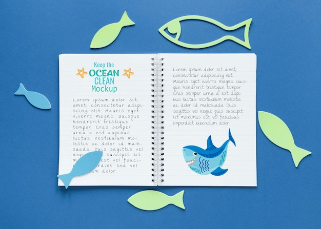 Ocean day mock-up notebook surrounded by fish