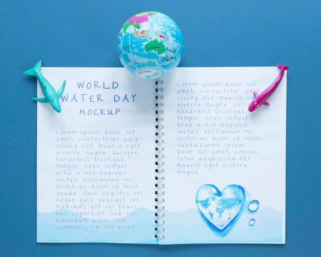 海の日のノートのモックアップと地球