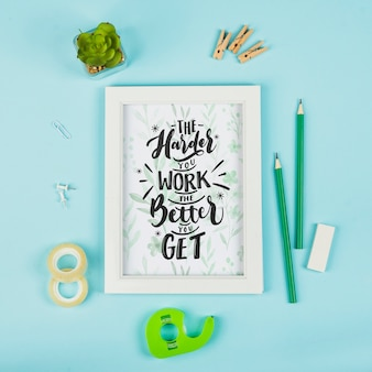 Office desk with positive message on frame