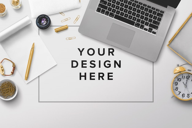 Office desktop mockup with laptop and papers