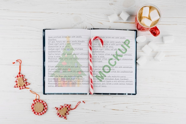Open book mockup with christmas decoration