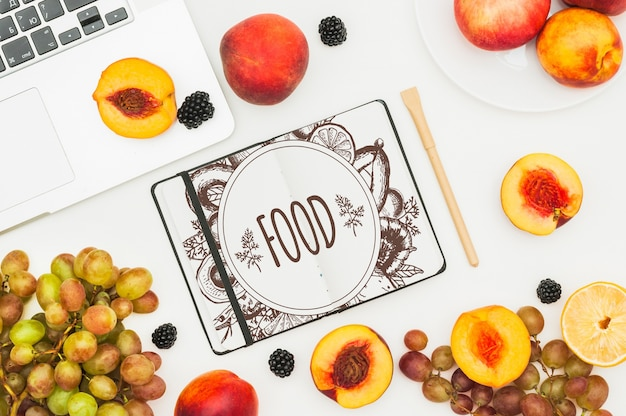 Open book mockup with fruits