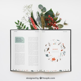 Open book mockup with leaves