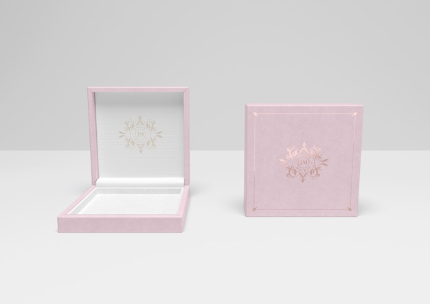 Open and closed pink gift box with cover