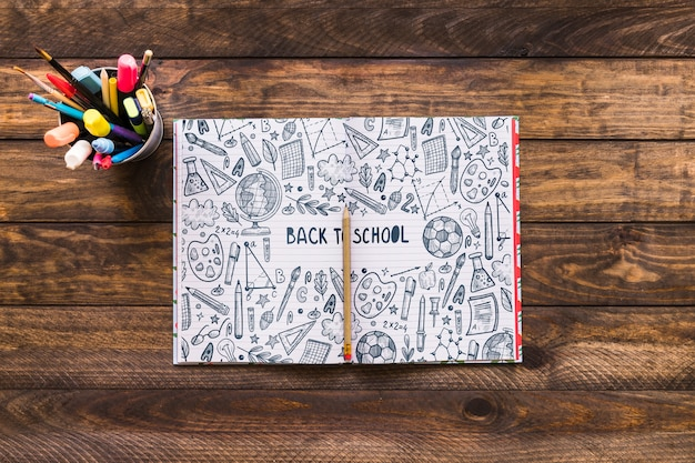 Open notebook mockup with back to school concept