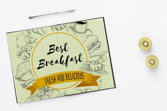 Open notebook mockup with breakfast concept