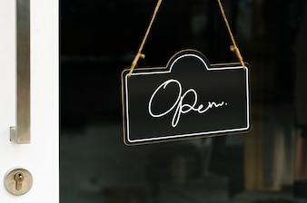 Open, wooden door sign mockup