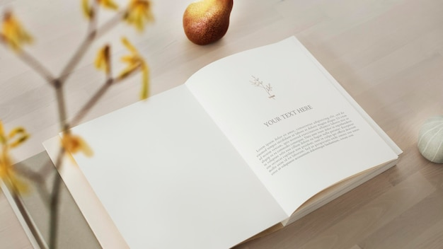 Opened book mockup on a wooden table