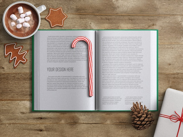 Opened book pages mockup with christmas decoration on wooden table