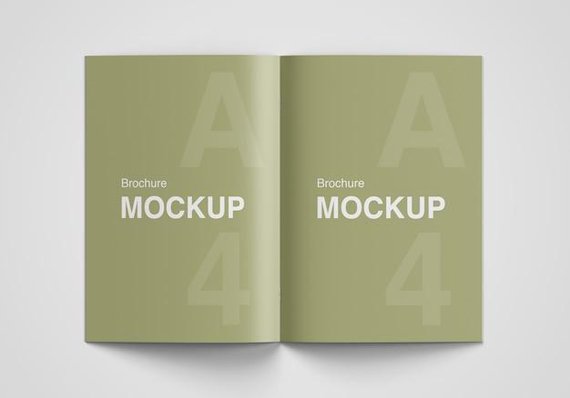 Opened brochure or magazine mockup top angle view