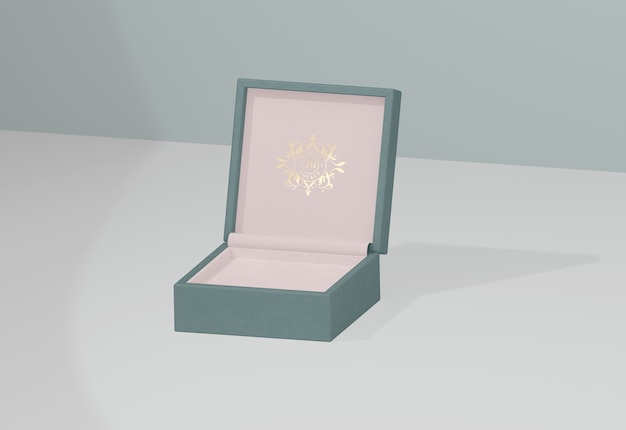 Opened and empty jewelry box with golden symbol