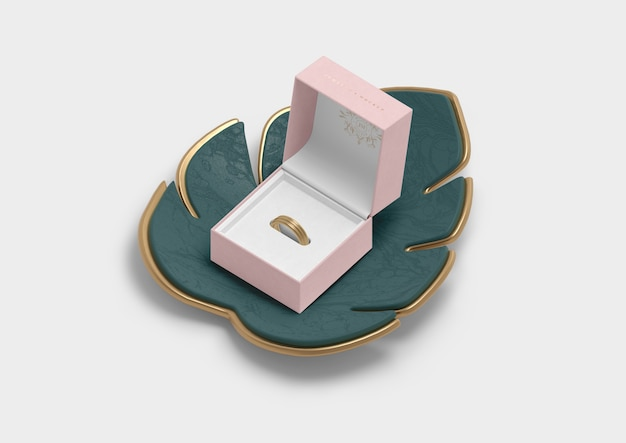 Opened jewellery box for ring and monstera leaf
