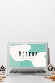 Opened laptop with screen mockup