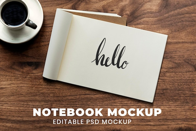 Opened notebook pages mockup psd on wooden background