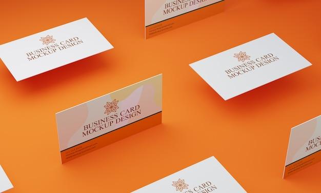 オレンジ色の背景の名刺のモックアップ
