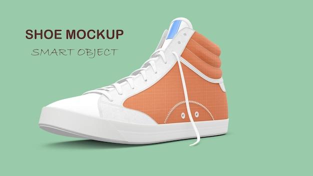 Изолированный макет обуви из ткани оранжевого цвета