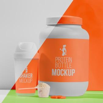 Pillole arancioni e concetto di mock-up palestra di proteine in polvere
