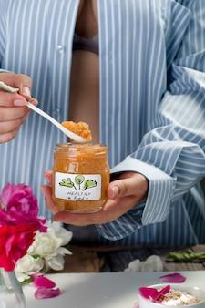 Orange puree in a jar mockup