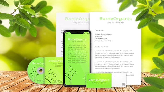 Organic corporate branding of iphone x, business cards, cd, and letters on rustic wooden table with natural, green