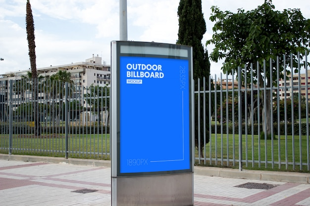Outdoor billboard next to park