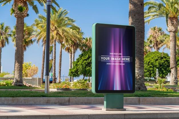 Outdoor billboard in seaside resort city mockup