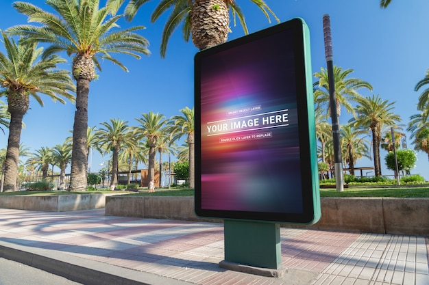 Outdoor street billboard advertisement in seaside resort city mockup