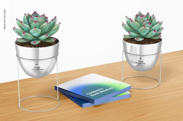 Vasi per piante ovali con supporto con mockup di libri