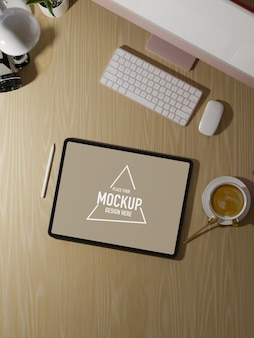 Overhead close up view working table with tablet white screen mockup computer wooden table