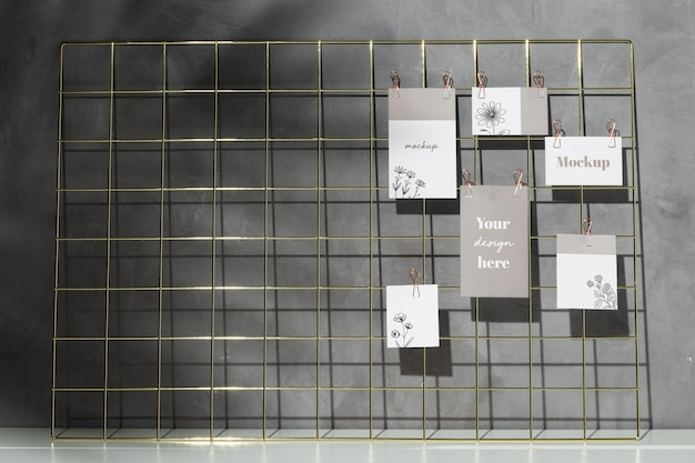 Pack of cards hanging on grid memo board with clips