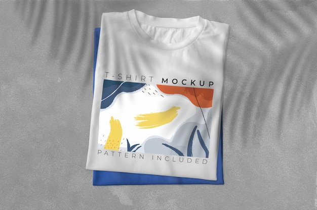 Pack of folded t-shirt with shadows mockup