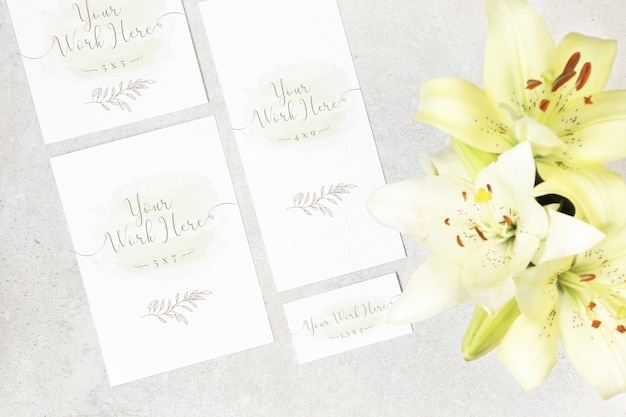 Package of wedding cards with flowers on grey background