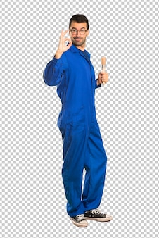 Painter man showing an ok sign with fingers
