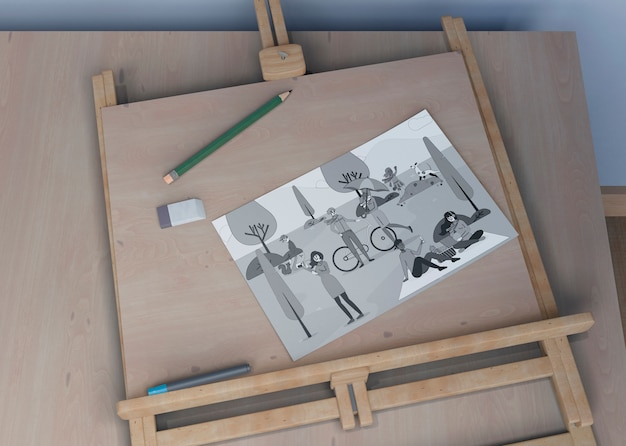Painting support with sheet sketch on desk