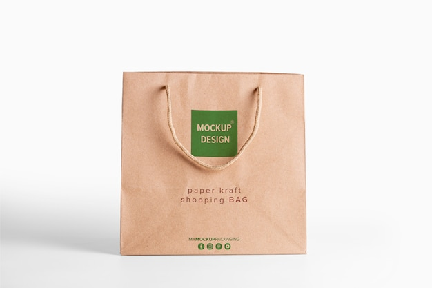 Paper bag brown mockup for merchandise. corporate packaging template with logo. psd front view editable kraft package