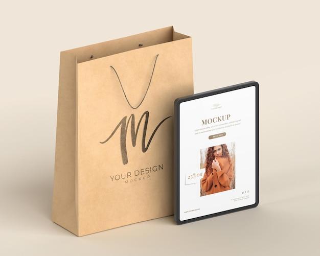 Paper bag and tablet arrangement mockup