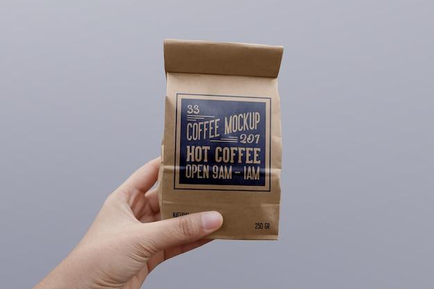 Paper coffee bag mockup on hand