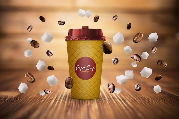Paper coffee cup and beans in gravity mockup free psd